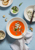 Pumpkin soup with blue cheese on a blue stone background. Royalty Free Stock Photography