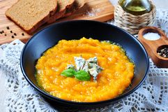 Pumpkin soup with blue cheese and olive oil Royalty Free Stock Images