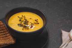 Pumpkin soup with blue cheese, thyme and slice of bread Royalty Free Stock Image