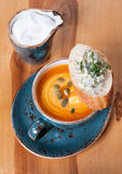 Pumpkin soup in a blue cup Royalty Free Stock Image