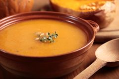 Pumpkin soup. Bowl with pumpkin soup and and baked butternut squash Royalty Free Stock Images