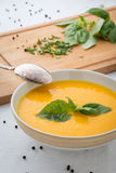 Pumpkin soup in bowl with basil Royalty Free Stock Image