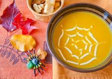 Pumpkin soup in a bowl. Stock Photos