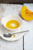 Pumpkin soup in a bowl with pumpkin seeds Royalty Free Stock Images