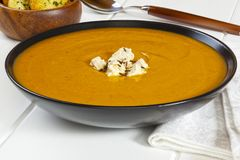 Pumpkin Soup in a Bowl stock photo