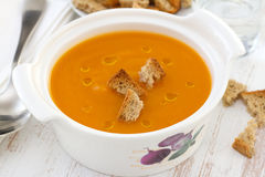 Pumpkin soup in bowl with spoon Stock Photo