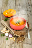 Pumpkin soup in bowl on vintage wooden background Stock Photography