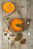 Pumpkin soup in bowl on wooden background Stock Image