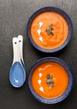 Pumpkin soup in bowls Stock Photos