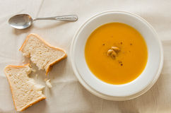 Pumpkin soup and bread Royalty Free Stock Image