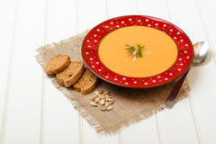 Pumpkin soup with bread crouton on white wooden table. Pumpkin soup with bread crouton on the white wooden table Royalty Free Stock Photography