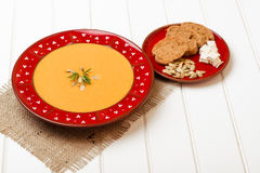 Pumpkin soup with bread crouton on white wooden table. Pumpkin soup with bread crouton on the white wooden table Stock Photography