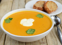 Pumpkin soup and bread Stock Photo
