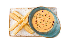 Pumpkin soup with bread sticks. Isolated on white background Stock Photography