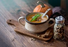 Pumpkin soup with bread. Tasty pumpkin soup with cereal bread, seasonal autumn food stock photography
