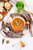 Pumpkin soup with bread on white background Stock Photos