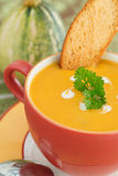 Pumpkin soup in Bright bowl with bread slice and parsley Royalty Free Stock Photography