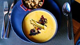 Pumpkin soup with caramelized apples Stock Photography