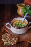 Pumpkin soup with cereal bread. Tasty pumpkin soup with cereal bread, seasonal autumn food royalty free stock images