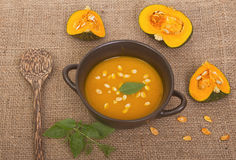 Pumpkin soup in clay pot Royalty Free Stock Photography