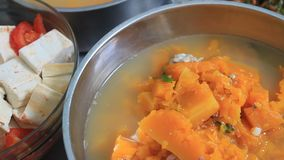 Pumpkin soup cooked pork stock video