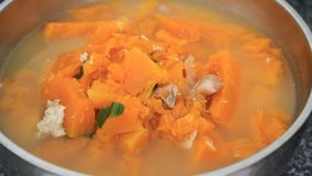 Pumpkin soup cooked pork stock video footage