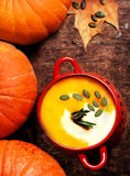 Pumpkin  soup with cream on dark wooden background Top view imag Royalty Free Stock Photos