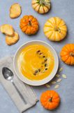 Pumpkin Soup with Cream, Dill and Pumpkin Seeds, Top View royalty free stock images