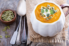 Pumpkin soup with cream, herbs and seeds Stock Photos