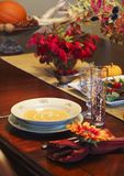 Pumpkin soup with cream on the holiday table stock photography
