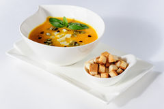 Pumpkin and soup with cream and pumpkin seeds Royalty Free Stock Photo