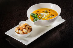 Pumpkin and soup with cream and pumpkin seeds Royalty Free Stock Image