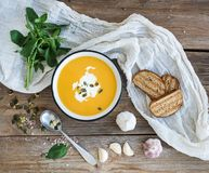 Pumpkin soup with cream, seeds, bread and fresh Royalty Free Stock Images