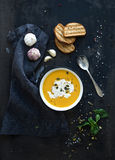 Pumpkin soup with cream, seeds, bread and fresh Stock Photo