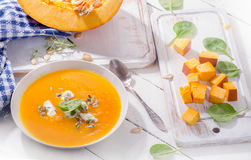 Pumpkin soup with cream royalty free stock images