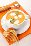 Pumpkin soup with cream and toast Stock Photos