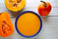 Pumpkin soup cream on wood Royalty Free Stock Images