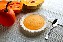 Pumpkin soup cream on wood Royalty Free Stock Photos