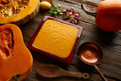 Pumpkin soup cream on wood Royalty Free Stock Photography