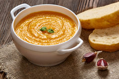 Pumpkin soup. Pumpkin creme soup on dark wooden background Stock Image