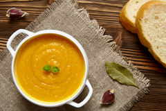 Pumpkin soup. Pumpkin creme soup on dark wooden background. Top view Royalty Free Stock Photos