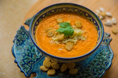 Pumpkin soup with croutons. Pumpkin soup puree with spices on a table Stock Image