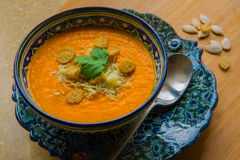Pumpkin soup with croutons. Pumpkin soup puree with spices on a table Stock Photos