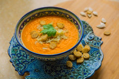 Pumpkin soup with croutons. Pumpkin soup puree with spices on a table Stock Photo