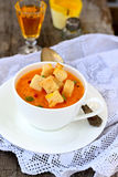 Pumpkin soup with croutons Stock Images