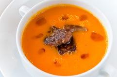 Pumpkin soup with foie gras. This is a close-up of a pumpkin soup with foie gras Stock Image