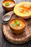 Pumpkin soup and fresh pumpkin Stock Photos