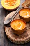 Pumpkin soup and fresh pumpkin Stock Images