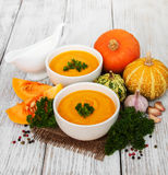 Pumpkin soup with fresh pumpkins Royalty Free Stock Photo