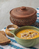 Pumpkin soup with fried onions and meat with bacon Stock Images